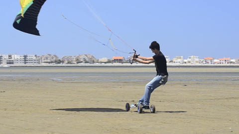 Paulo Azevedo on a landing kite Stock Video Footage
