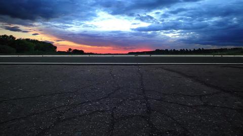 Sunset rays on road Footage