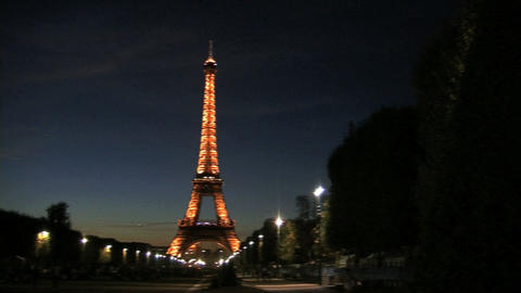 Pan from the Eiffel tower at night Stock Video Footage