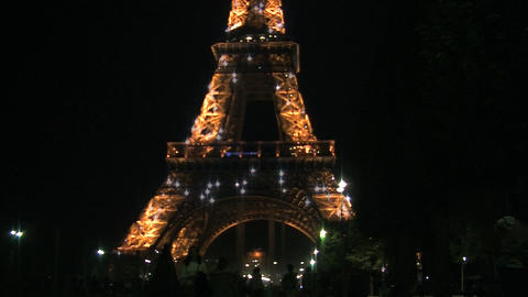 Eiffel tower at night from blur to focus Footage