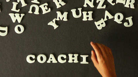 A person spelling Coaching Stock Video Footage