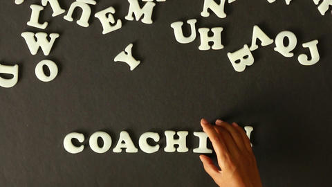 A person spelling Coaching Footage