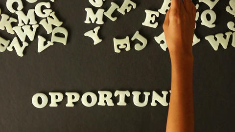 A person spelling Opportunities Stock Video Footage