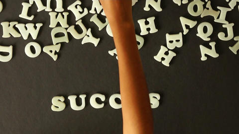 A Person Spelling Success stock footage