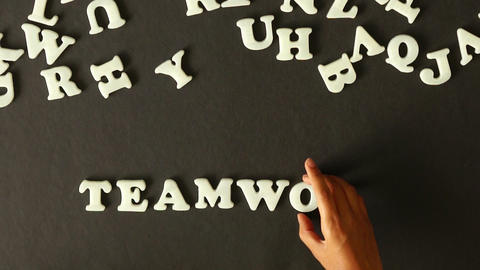 A person spelling Teamwork Stock Video Footage