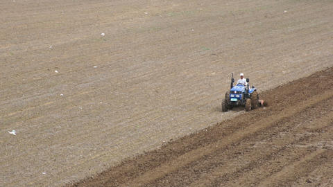 Tractor plowing the field 01 Stock Video Footage