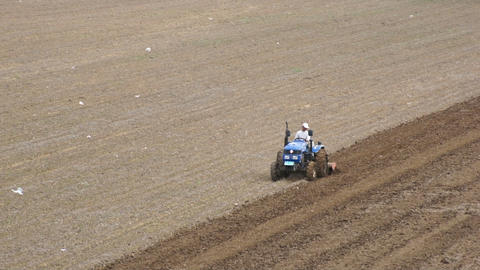 Tractor Plowing The Field 01 stock footage