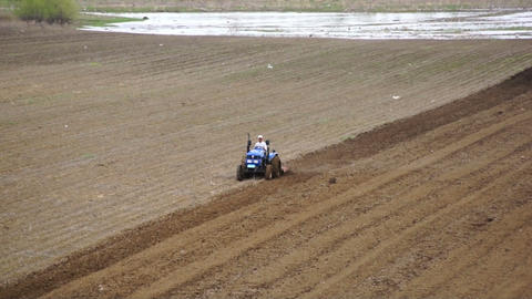 Tractor plowing the spring field 04 Footage