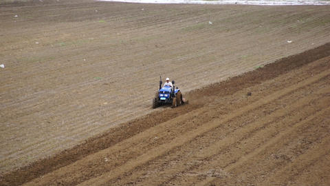 Tractor plowing the spring field 04 Stock Video Footage