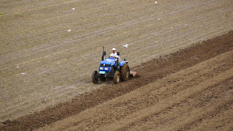 Tractor plowing the spring field 06 Footage