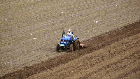 Tractor plowing the spring field 06 Stock Video Footage