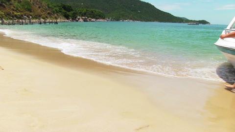 Boy runs into tropical sea Stock Video Footage