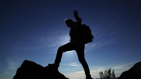 Woman overcomes difficult mountain peaks Stock Video Footage