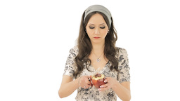 Brunette peeling an apple Stock Video Footage