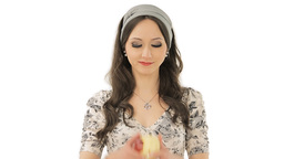 Lovely brunette enjoying the taste of an apple Stock Video Footage