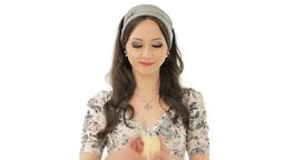 Lovely brunette enjoying the taste of an apple Stock Video Footage