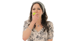 Lovely brunette eating sour apple Stock Video Footage