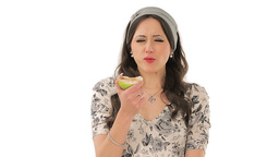 Lovely brunette eating sour apple Stock Video Footage