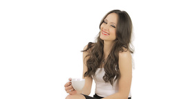 Beautiful brunette smiling and holding a cup of coffee,... Stock Video Footage