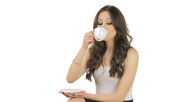 Lovely brunette satisfied by the taste of the coffee Stock Video Footage