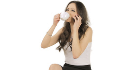 Brunette speaking on phone while drinking coffee Stock Video Footage