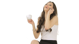Brunette speaking on phone while drinking coffee Footage