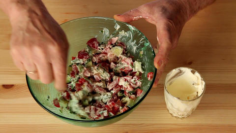 Making salad from onion and other vegetables 7a Stock Video Footage