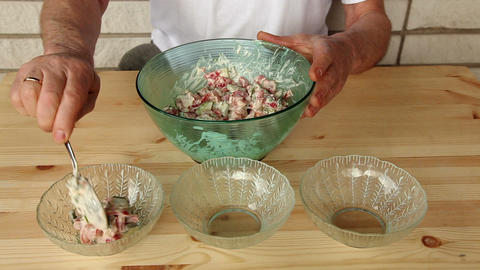 Distributing salad into small glass plates 8b Stock Video Footage