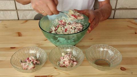 Distributing salad into small glass plates 8b Footage