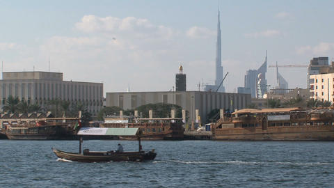 Little ferry passing by with the Burj khalifa at the... Stock Video Footage