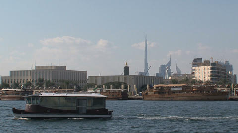 Ferry with the burj khalifa at the background Stock Video Footage