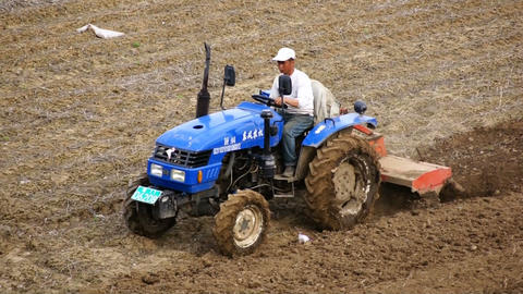 Tractor Plowing The Field 08 (tracking Shot) stock footage