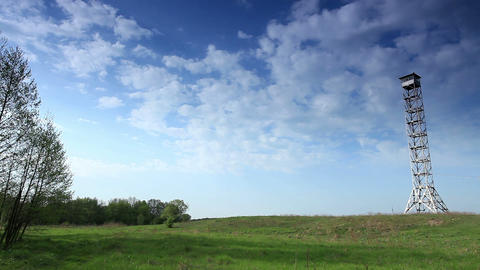 movement of clouds over a field and an observation tower (timelapse) Footage