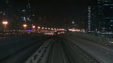 Metro train driving through Dubai Stock Video Footage
