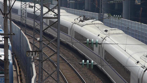 overlook high-speed rail slowly pulling out of the station Stock Video Footage