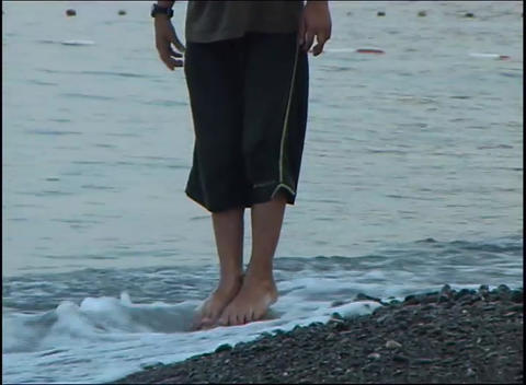 boy walking on sea beach Stock Video Footage