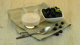 Yogurt and blueberries Stock Video Footage