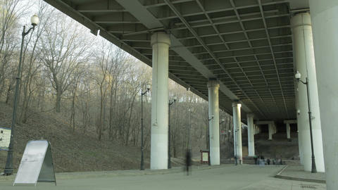 People in blur walking under the bridge Stock Video Footage