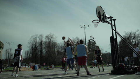 Teenagers playing basketball 1 Stock Video Footage