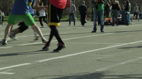 Men playing basketball in a city park. Sequence Stock Video Footage
