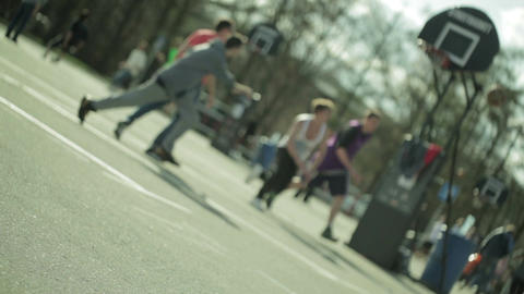 Teenagers playing basketball in a city park. Blured Footage