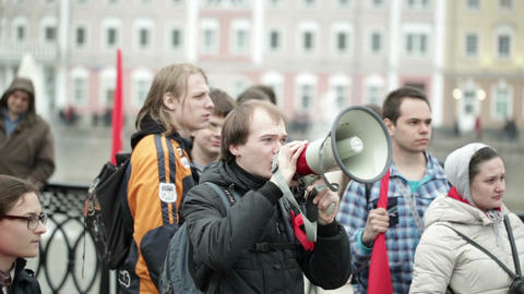 Young man shouting with a megaphone at the protest... Stock Video Footage