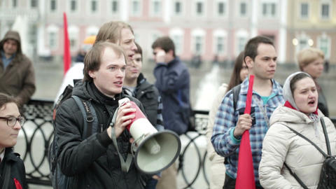 Young man shouting with a megaphone at the protest manifestation Footage