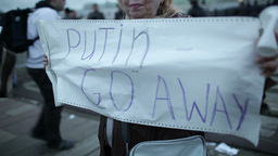 Woman holds a placard Putin Go Away Stock Video Footage