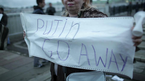 Woman holds a placard Putin Go Away Footage