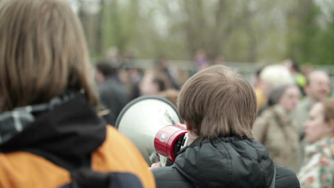 Young man shouting with a megaphone Stock Video Footage