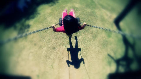 Little girl smiling on a swing in summer park Stock Video Footage