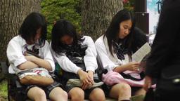 Japanese Schoolgirls Relaxing in Park in Yokohama Japan 12 Stock Video Footage