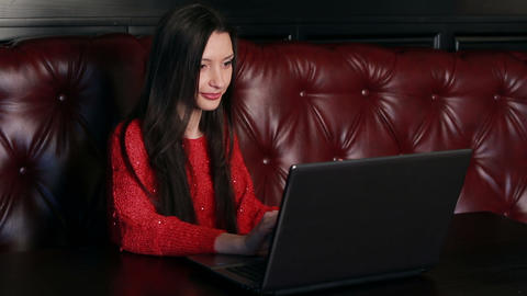 Girl With A Laptop In A Restaurant stock footage