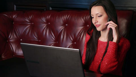 girl with a laptop in a restaurant Stock Video Footage